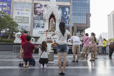 sacred trinity: BANGKOK, THAILAND - APR 17 : Unidentified tourist worship in Trimurati shrine at Central world in Ratchaprasong area on april 17, 2016. Thailand. Trimurati shrine is one of sacred item in Ratchaprasong area Editorial
