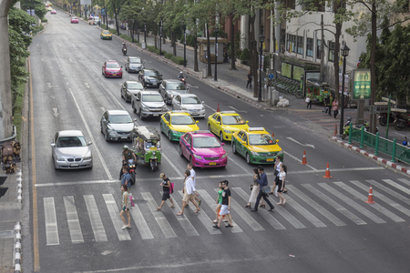BANGKOK THAILAND - APR 17 : unidentified  people walk across crosswalk at Ratchaprasong Junction near Erawan shrine on april, 17, 2016, thailand. Ratchaprasong Junction one of  is famous landmark of Bangkok