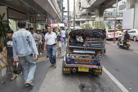 three wheeler: BANGKOK THAILAND - APR 30 : tuktuk parking near Seven - Eleven store in siam square on april, 30, 2016, thailand. tuktuk is name of three wheeled taxi car in thailand