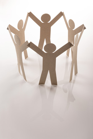 collectives: circle link of six paper figure in hand up posture on white background Stock Photo