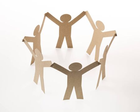circle joining of six paper figure in hand up on white background Stock Photo