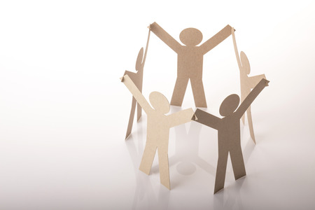 circle joining of five paper figure in hand up posture on white background