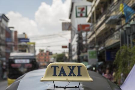 tuktuk: BANGKOK THAILAND - JUL 24 : taxi cab sign  on top tuktuk car near Khaosan road on july, 24, 2016, thailand. tuktuk is popular taxi service for tourists