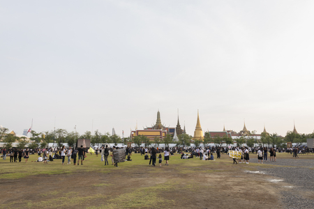 adulyadej: BANGKOK THAILAND - OCT 19 : A crowd of mourners at Sanam Luang, while the body of Thailand Bhumibol Adulyadej keep in Grand Palace on october, 19, 2016