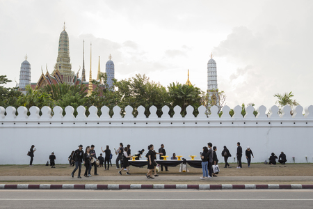 adulyadej: BANGKOK THAILAND - OCT 28 : crowd of mourners worship at wall of Wat Phra Kaew, while the funeral of king Bhumibol Adulyadej in Grand Palace on october, 28, 2016