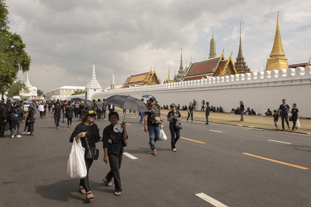 adulyadej: BANGKOK THAILAND - OCT 23 : snap shot of mourners on Na Phra Lan road in Sanam Luang area, while the funeral of king Bhumibol Adulyadej in Grand Palace on october, 23, 2016