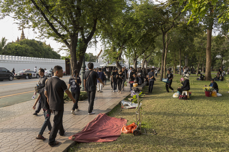 BANGKOK THAILAND - OCT 23 :  The mourners on Sanam Chai road on the way to Sanam Luang, while the funeral of king Bhumibol Adulyadej in Grand Palace on october, 23, 2016