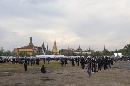 adulyadej: BANGKOK THAILAND - OCT 29 : A crowd of mourners at Sanam Luang, while the body of Thailand Bhumibol Adulyadej keep in Grand Palace on october, 29, 2016