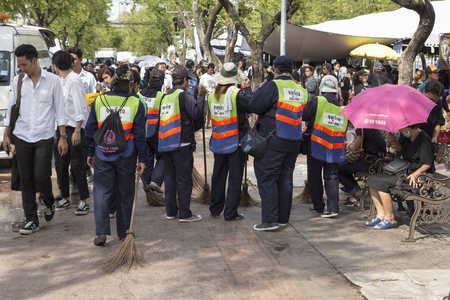 1 and group: BANGKOK THAILAND - NOV 1 : group of cleaner staff in Sanam Luang, while the funeral of king Bhumibol Adulyadej in Grand Palace on november, 1, 2016 Editorial