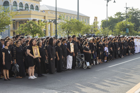 adulyadej: BANGKOK THAILAND - NOV 22 : The group  of mourners in national ceremony for king Rama 9 at ministry of Defence, while the funeral of king Bhumibol Adulyadej in Grand Palace on november, 22, 2016