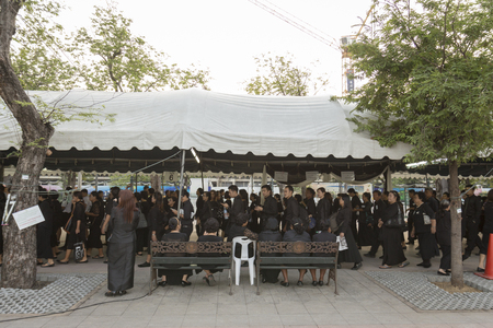 adulyadej: BANGKOK THAILAND - NOV 22 : line up of mourners in sanam luang for into Grand Palace ,while the funeral of king Bhumibol Adulyadej  on november, 22, 2016