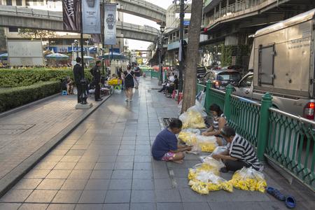 phrom: BANGKOK,THAILAND - NOV 26 : garland seller near Erawan shrine at Ratchaprasong Junction in morning on november 26, 2016. Erawan shrine is famously sacred place in bangkok