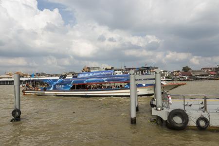 chao phraya: BANGKOK THAILAND - NOV 19 : ferryboat with tourist in chao phraya river near Wat Arun temple on november, 19, 2016, thailand. chao phraya river is famous sightseeing route of Bangkok