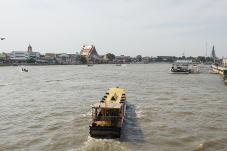 BANGKOK THAILAND - NOV 22 : small ferryboat in chao phraya river near Memorial Brigde on november, 22, 2016, thailand. chao phraya river is famous sightseeing route of Bangkok
