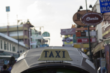 three wheeler: BANGKOK THAILAND - DEC 24 : taxi cab of tuktuk service car in Khao San road on december 24, 2016. tuktuk is popular server for tourist in Bangkok. Editorial