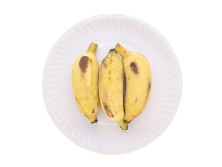 isolated of three banana on paper dish on white background