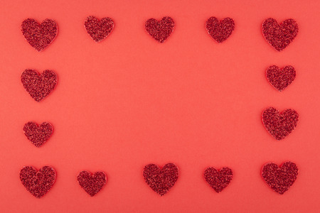 glister: background of glitter red heart array frame on red paper
