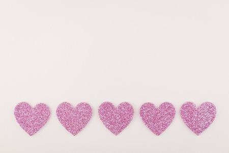 glister: big glitter pink heart decorate on white paper background Stock Photo