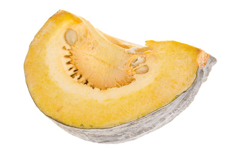 view of cutting yellow pumkin isolated on while background