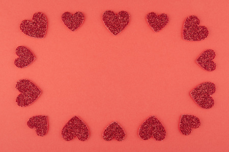 glister: rectangle glitter red heart frame on red paper background
