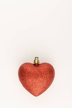 glister: red heart ornament with space on white paper background
