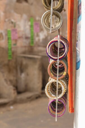 shopfront: close up of hanging display of art crafts bangle in shopfront at Pushkar Rajasthan, India. Stock Photo