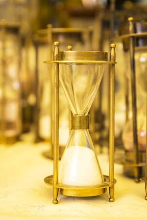 shopfront: display brass hourglass in shopfront in Dilli Haat, Delhi, India. Dilli Haat is traditional marketplace in delhi