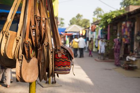 shopfront: india art style bag display of shopfront in Dilli Haat, Delhi, India. Dilli Haat is traditional marketplace in delhi Stock Photo