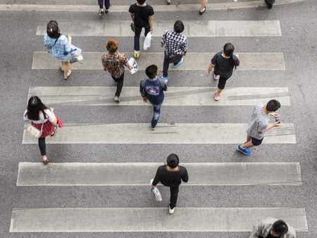 top view scene pedestrian crowded crossing on zebra way Stock Photo