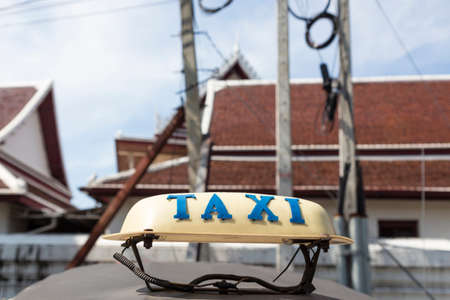taxi cab on top of tuk tuk car in background of temple, Bangkok, Thailand. tuk tuk is tradition taxi of thailand