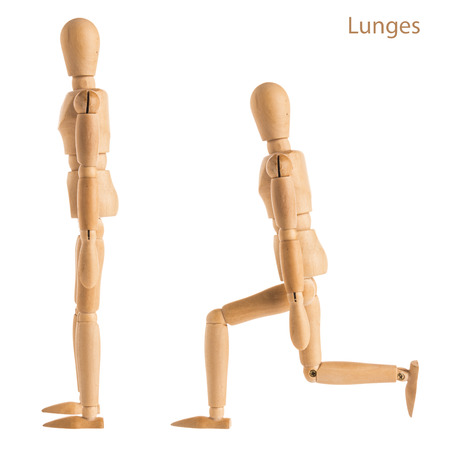 demonstration of wood manikin in lunges exercise pose on white background.