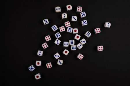 many white dice fall on black paper background, concept for business risk, chance, good luck or gambling Stock Photo