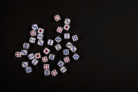 background of pitching random dice on black paper, concept for business risk, chance, good luck or gambling Stock Photo
