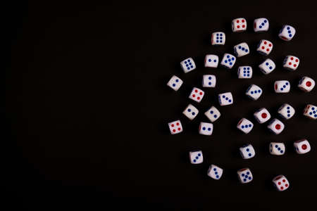 background of pitching dice on black paper with space, concept for business risk, chance, good luck or gambling
