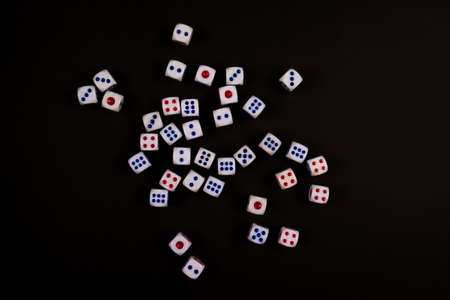 many dice fall on black paper background, concept for business risk, chance, good luck or gambling Stock Photo