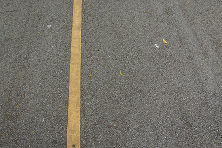 background of yellow solid line on gray roadway with blank space