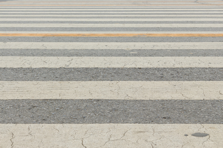 background of white line pattern of zebra way, shallow depth of field. Stock Photo