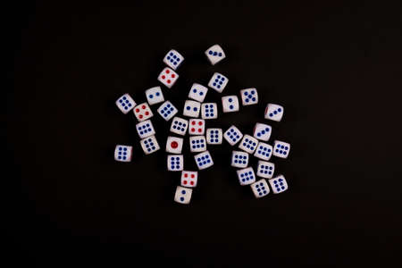 the group of dice concept for business risk, chance, good luck or gambling, black paper background