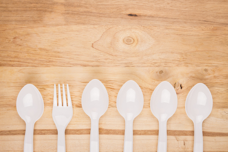 wooden background of white plastic fotk in spoon line decoration Stock Photo