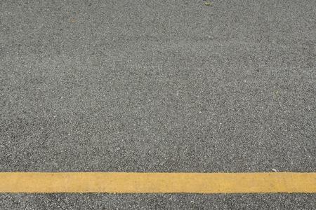 空白部分の道路と黄色線の表面の背景 写真素材