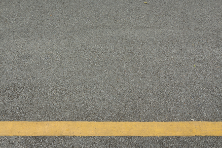 surface background of roadway and yellow line with blank space Stock Photo