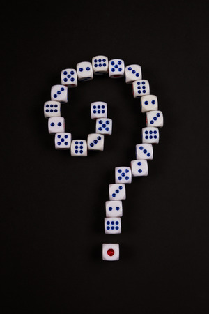 question mark symbol from dice array on black background Stock Photo