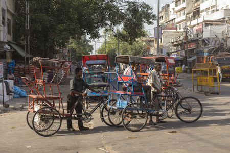 live work city: DELHI INDIA-JUN 10 : local rickshaw in old delhi. rickshaw as three wheeler bike taxi in local area of delhi on june, 10, 2015, india Editorial