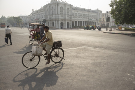 ourdoor: DELHI INDIA-JUN 18 : morning scene of traffic at Connaught place in central delhi of delhi on june, 18, 2015, india. this place is large shopping place in central delhi