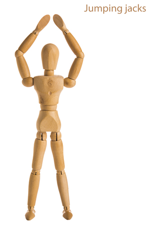 demonstration of wood manikin in jumping jacks  exercise pose on white background. Stock Photo