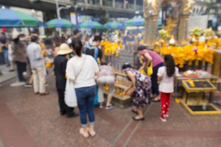 blurred background  of worship people in Erawan shrine at Ratchaprasong Junction in Bangkok Thailand.