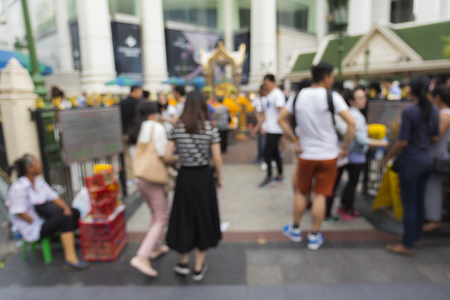 blurred background  of in front of Erawan shrine at Ratchaprasong Junction in Bangkok Thailand.