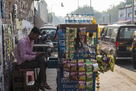 DELHI, INDIA - November 2 2014 : snack and betel stall near New Delhi Railway Station, Paharganj side. Editorial