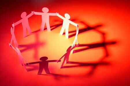 circle joining of paper figure on red light background. in concept of business, cooperation and critical.