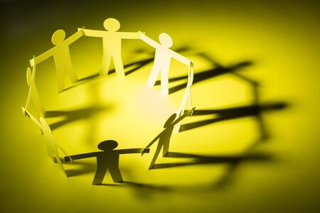 circle joining of paper figure on yellow light background. in concept of business, cooperation and warning.